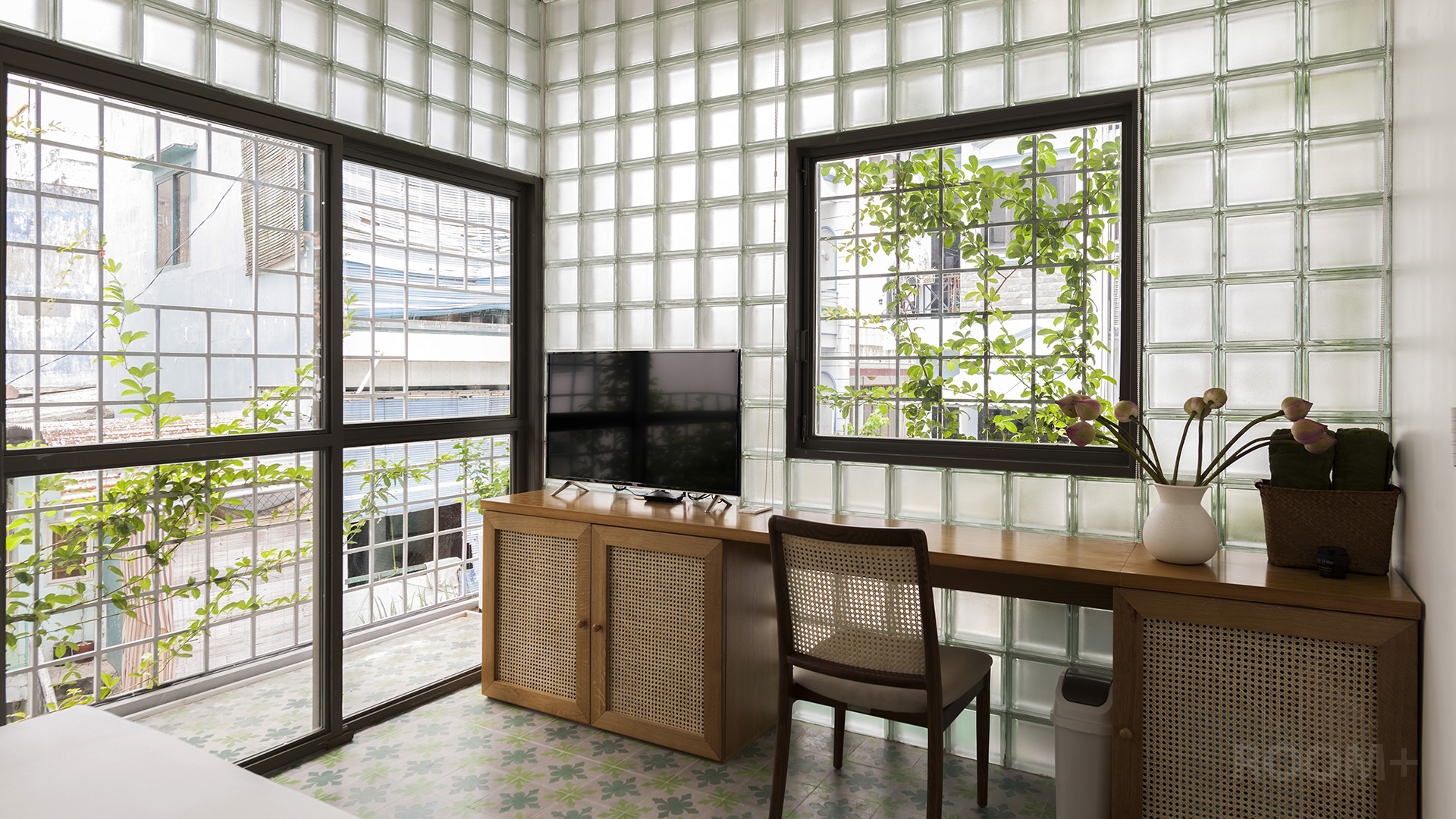 Renovates tiny house in vietnam with glass-block facades